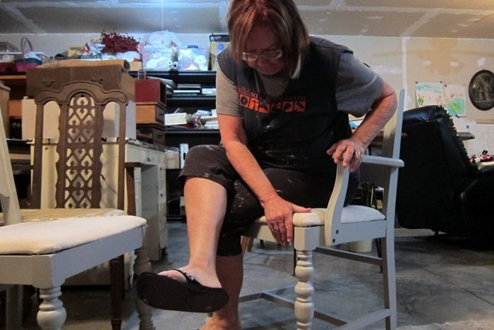 Kathy Owen Petticoat Junktion working on a paint project
