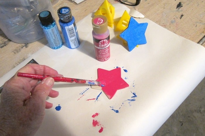 painting a wood star for the tree