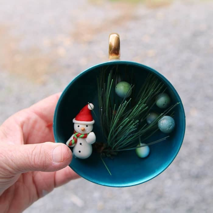 use hot glue to add decor to teacup ornaments