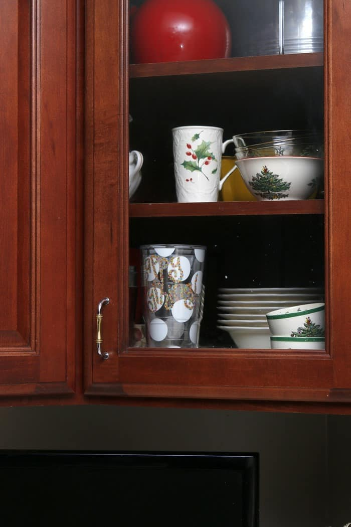 Christmas dishes in the cabinets for display