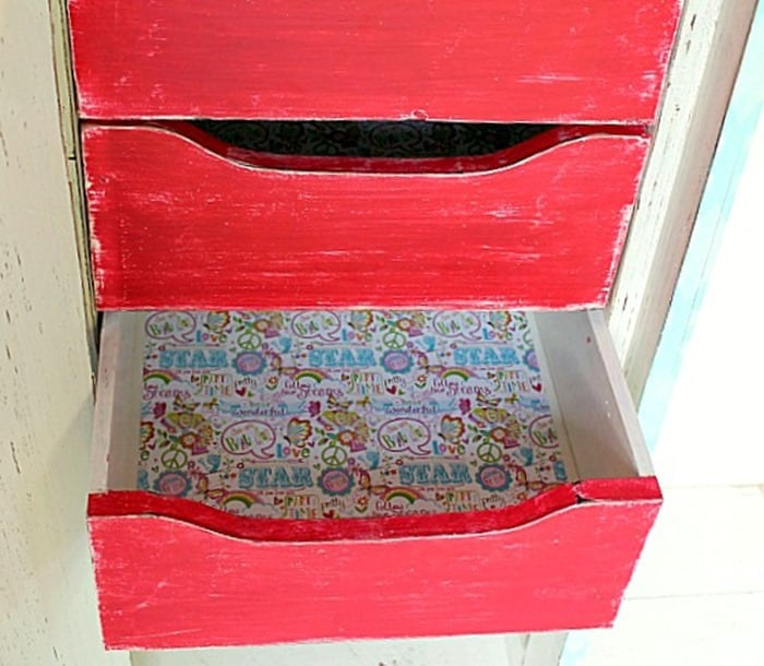 Line furniture drawers with scrapbook paper