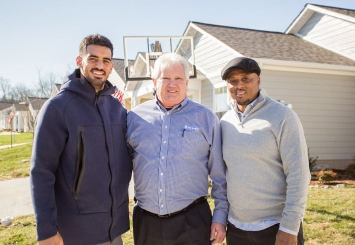 Marcus Mariota, Aarons Rentals, and Warrick Dunn, making a new homeowner very happy with their generosity.