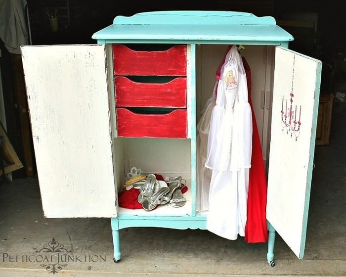 Vintage wardrobe painted and stenciled inside and out makes a great place to store kids dress up clothes