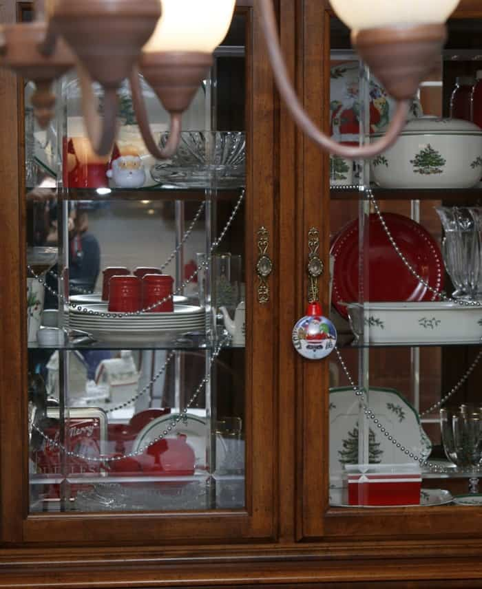 china cabinet with Christmas dishes