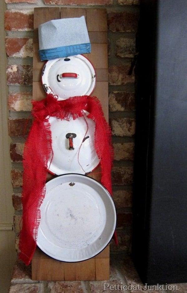 snowman made out of enamel pot lids