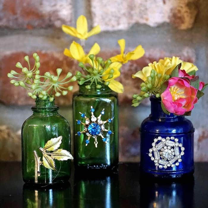 how to make decorative bottle vases by adding jewelry and ribbon