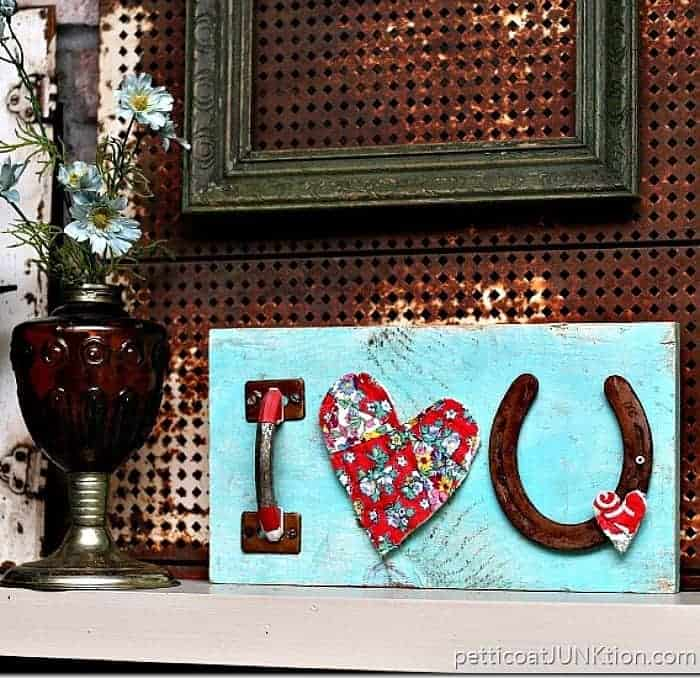 say I love you with reclaimed junk and make a wall sign
