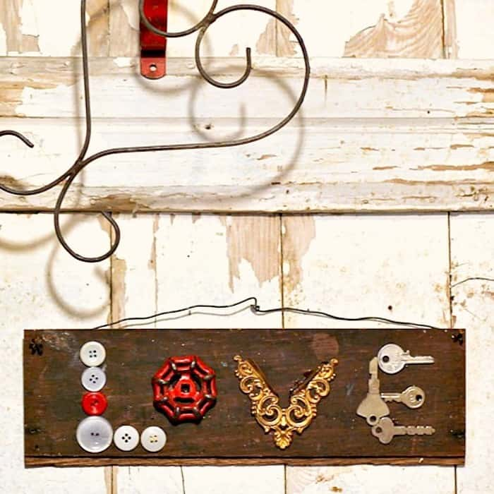 make a wall sign using buttons and hardware
