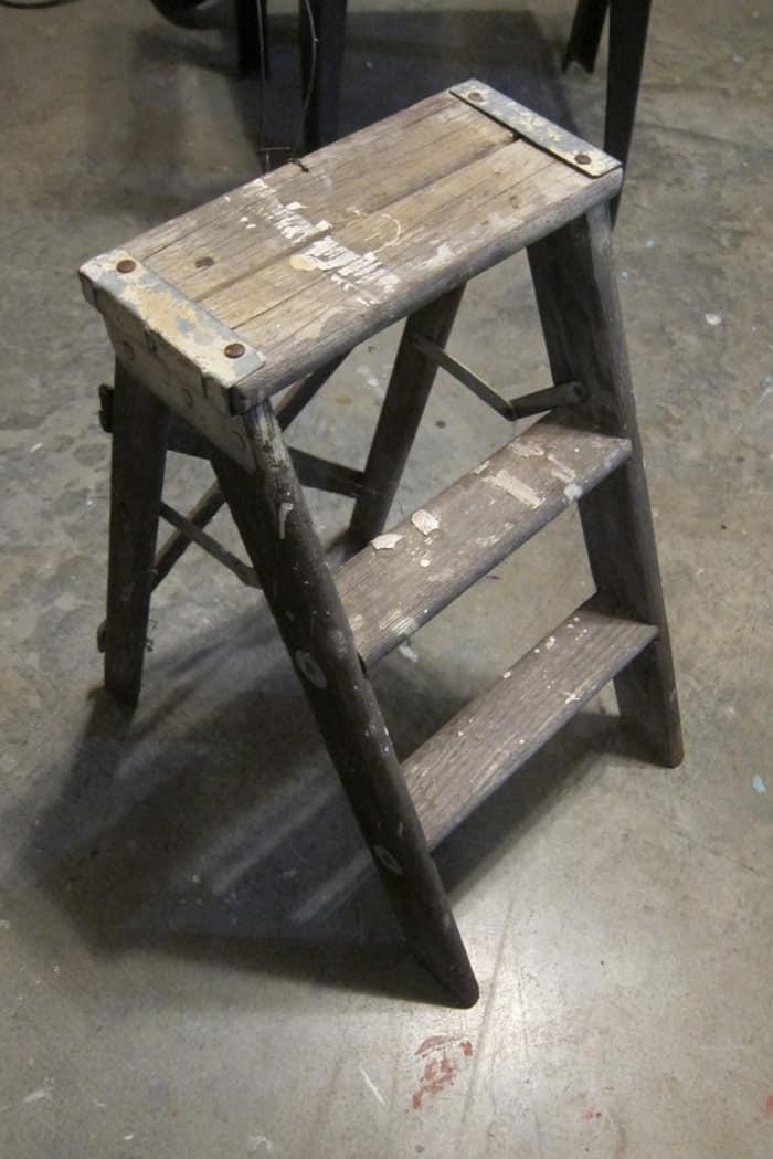 small paint splattered step stool