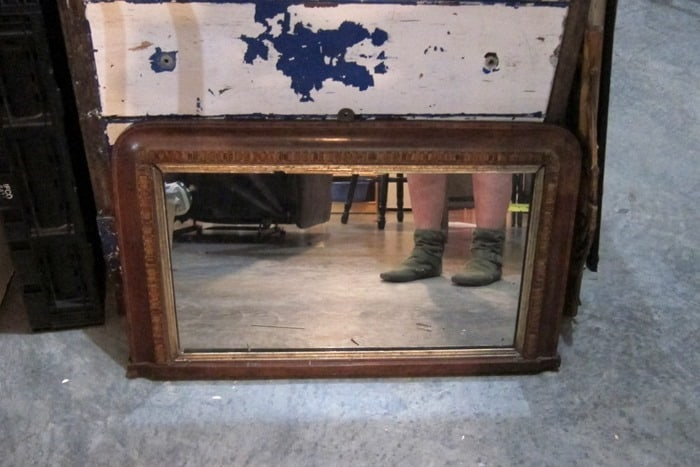 vintage waterfall mirror is an auction purchase