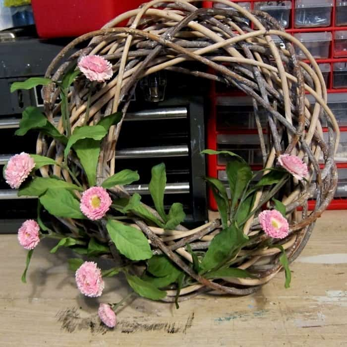 decorate a wreath with flowers