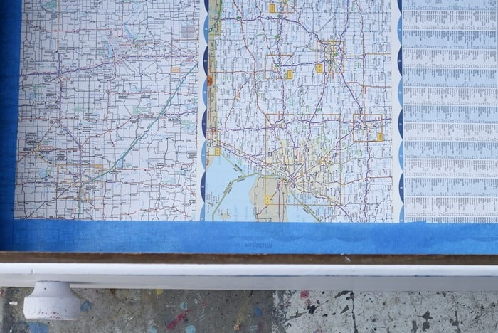 use blue painters tape to secure atlas map pages to furniture drawers for liners