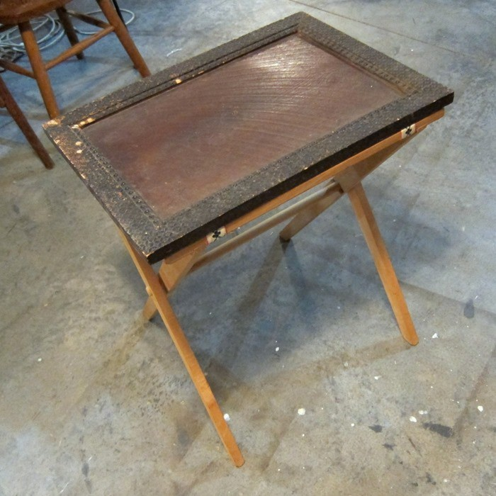 vintage frame becomes a topper for a folding tray stand