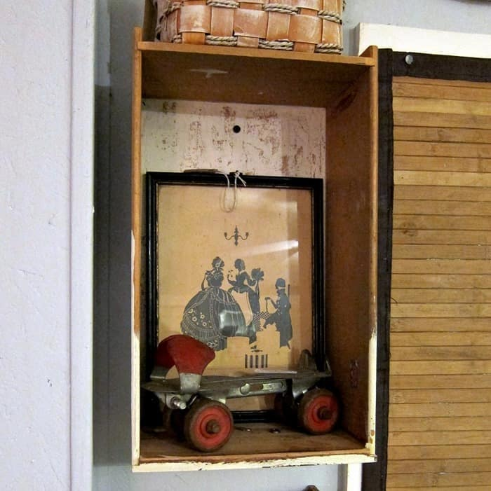 wood drawers hanging on the wall as display pieces