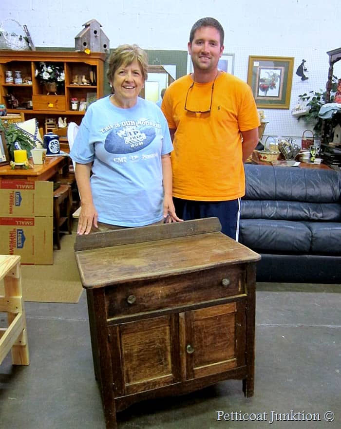 Paula and her son at the furniture workshop