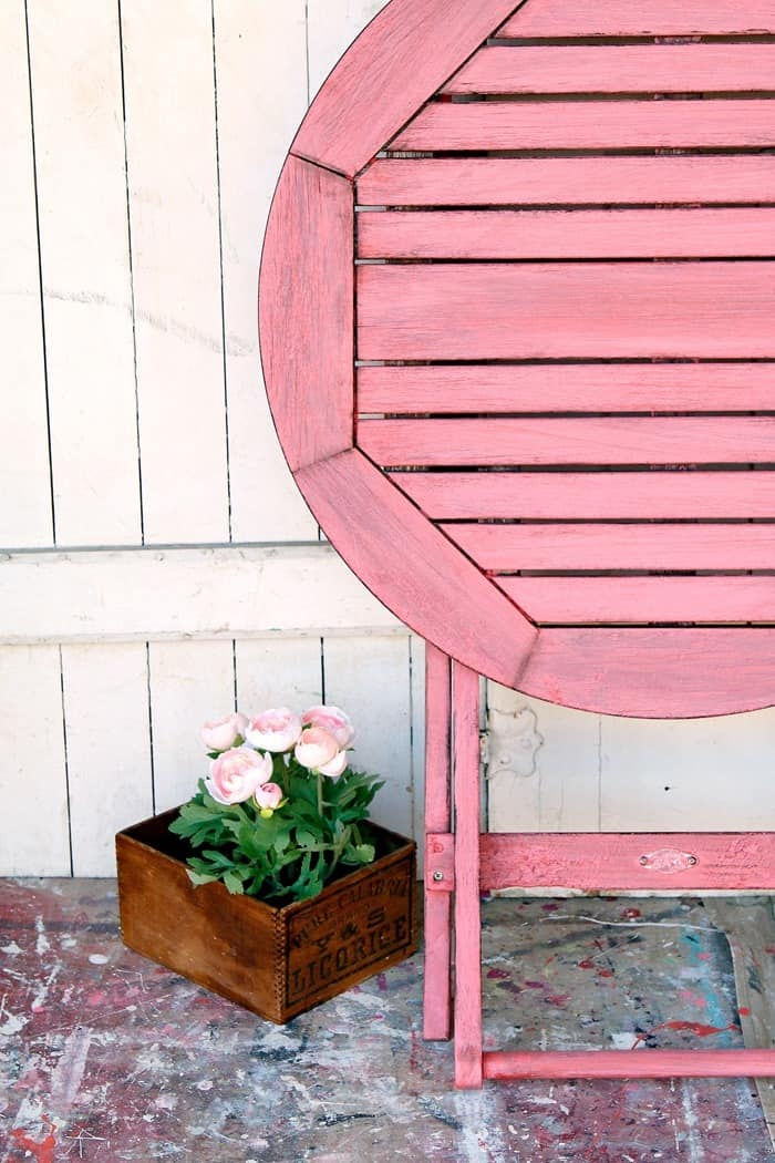 You can paint an outdoor wood table to look naturally aged
