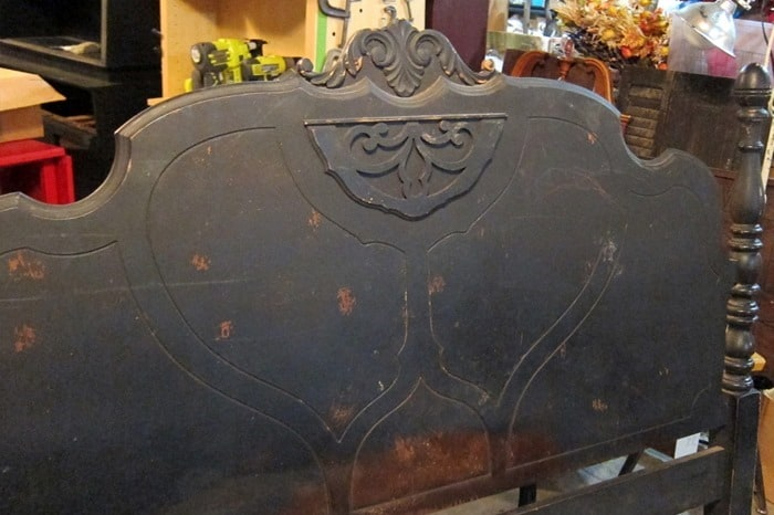 antique bed headboard with carved wood detail