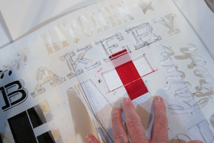 how to stencil a red cross on a book