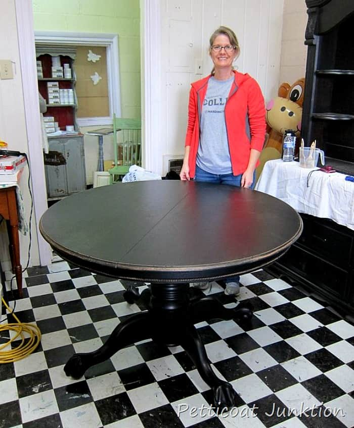 paint a solid wood dining room table black and distress the paint
