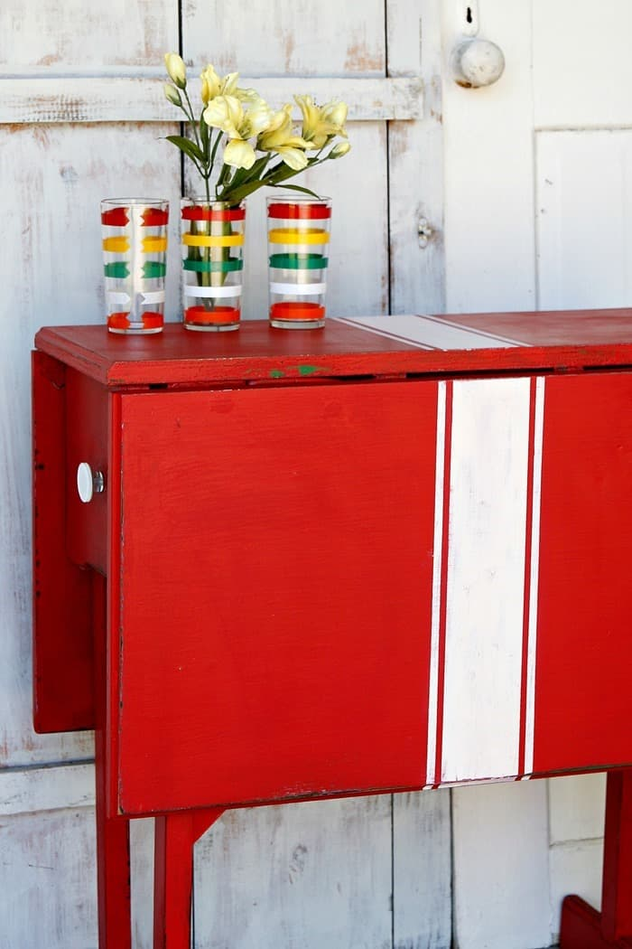 red drop leaf table with drawers