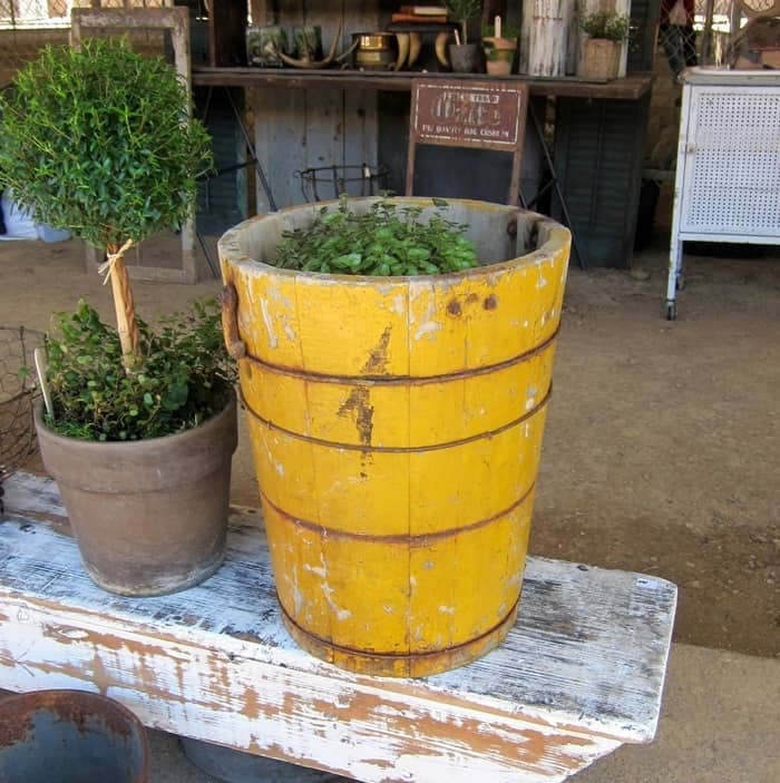 vintage wood hand crank ice cream bucket painted yellow spotted at the Nashville Flea Market