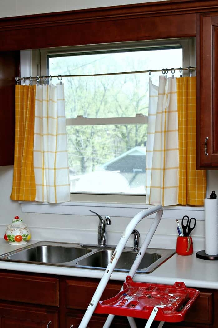 IKEA dish towels make great curtain tiers. Just hang with clips from decorative rod.
