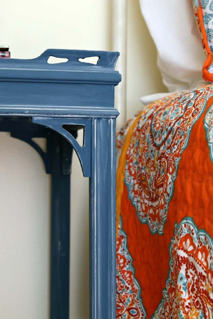 Tuscan blue painted table with white wax details
