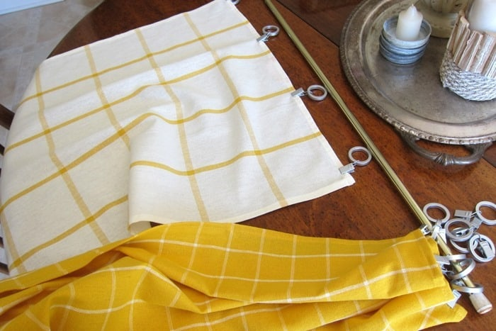 attach dish towels to curtain hooks