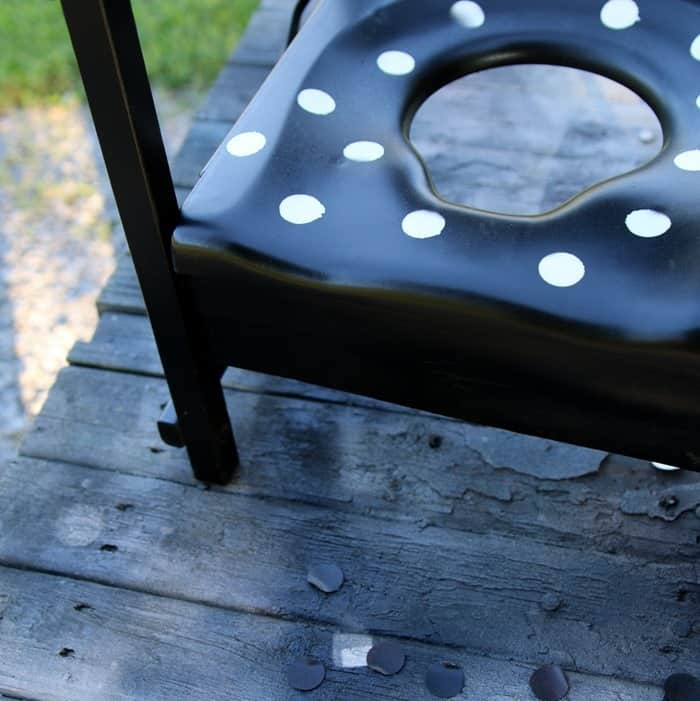 black and white polka dot potty chair turned planter
