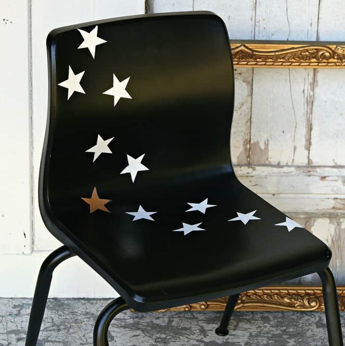 black spray paint and star decals make fun furniture
