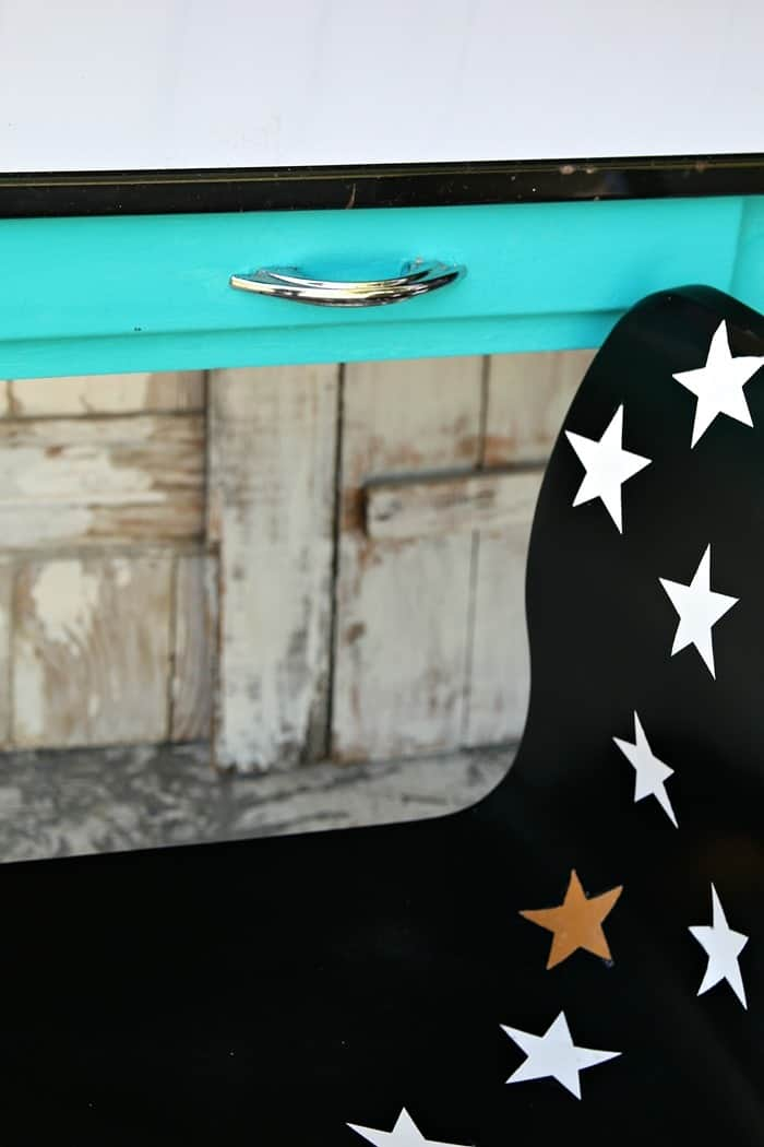 black spray paint and star decals turn a ho hum chair into a work of art