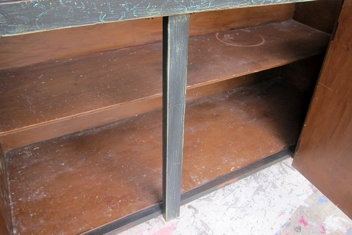 stained and scratched shelves