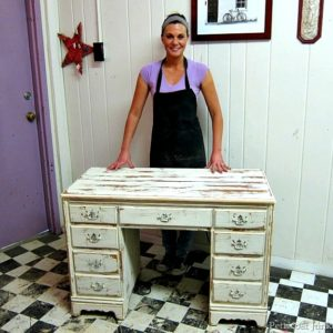 white distressed desk painted by student at a furniture painting workshop