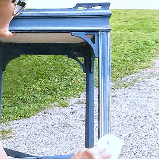 wipe wax onto details on painted furniture