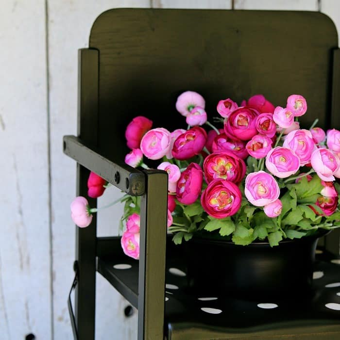 wood potty chair repurposed into a black and white trendy flower planter