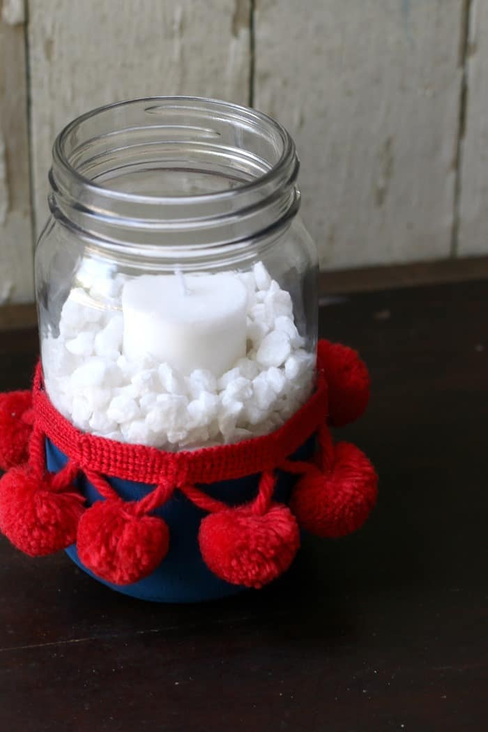 make a red white and blue candle holder using a mason jar and pom pom fabric trip