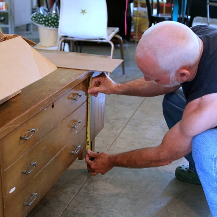 making furniture repairs on a vintage cedar chest