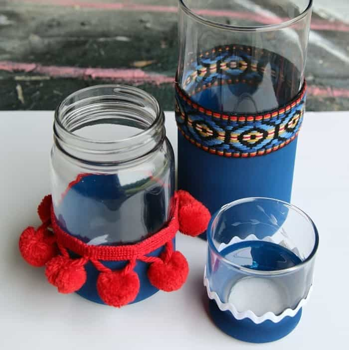 red white and blue jars and vases ready for candles