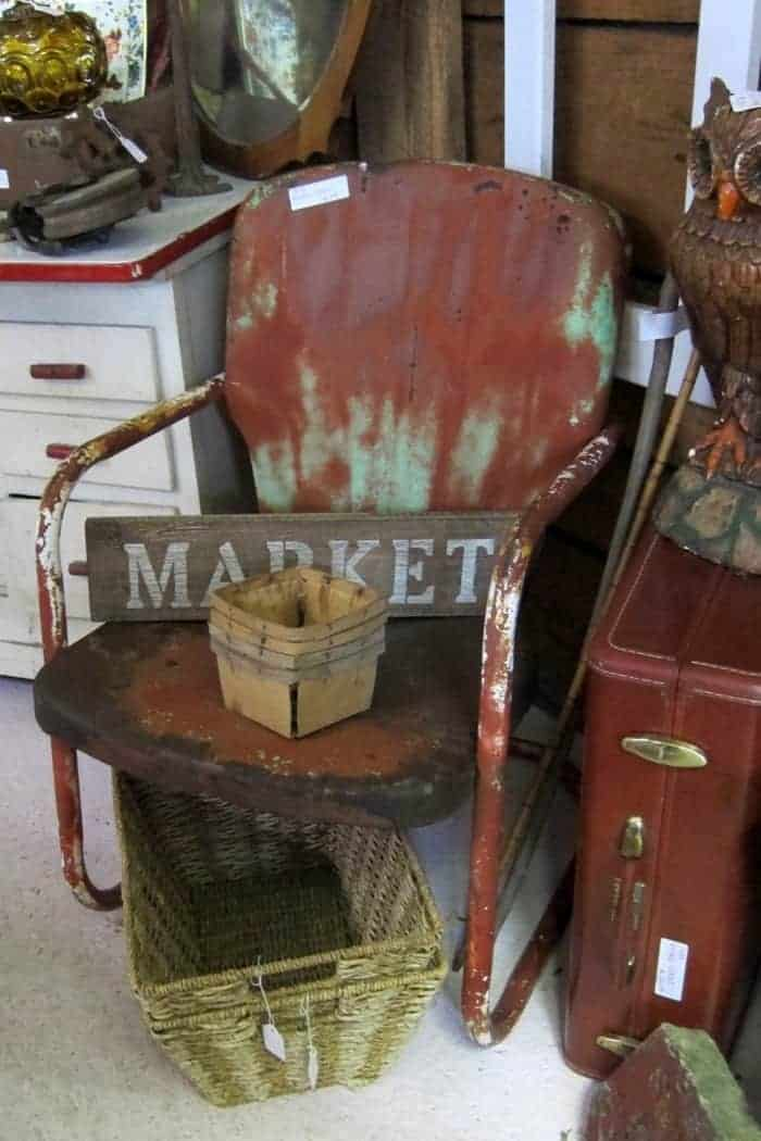 rusty chipped vintage metal lawn chair