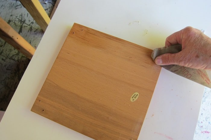 using sandpaper to smooth rough wood