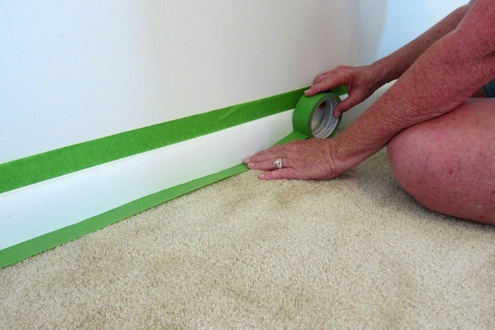 FrogTape used to protect carpet when painting wall molding