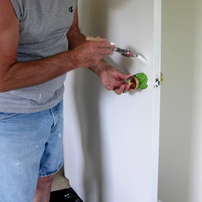 apply painters tape around door knobs when painting a door