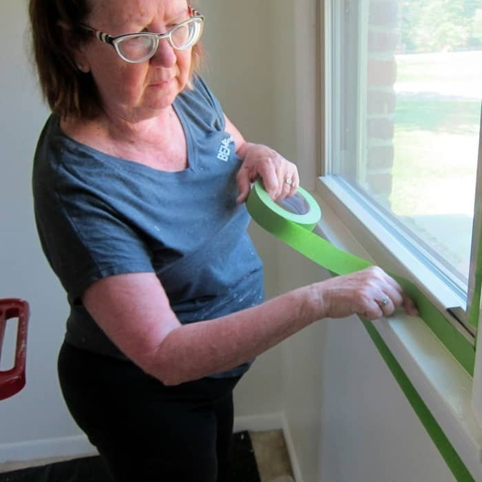 apply painters tape around trim to protect walls when painting