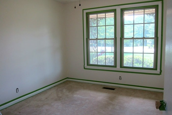 bedroom ready to paint using FrogTape to prevent paint from getting on walls and windows