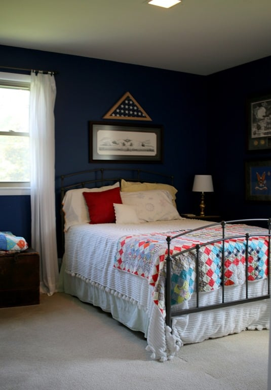blue bedroom with red accents