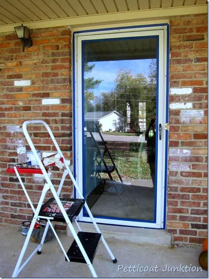 did you know you can paint a metal storm door with primer and latex paint