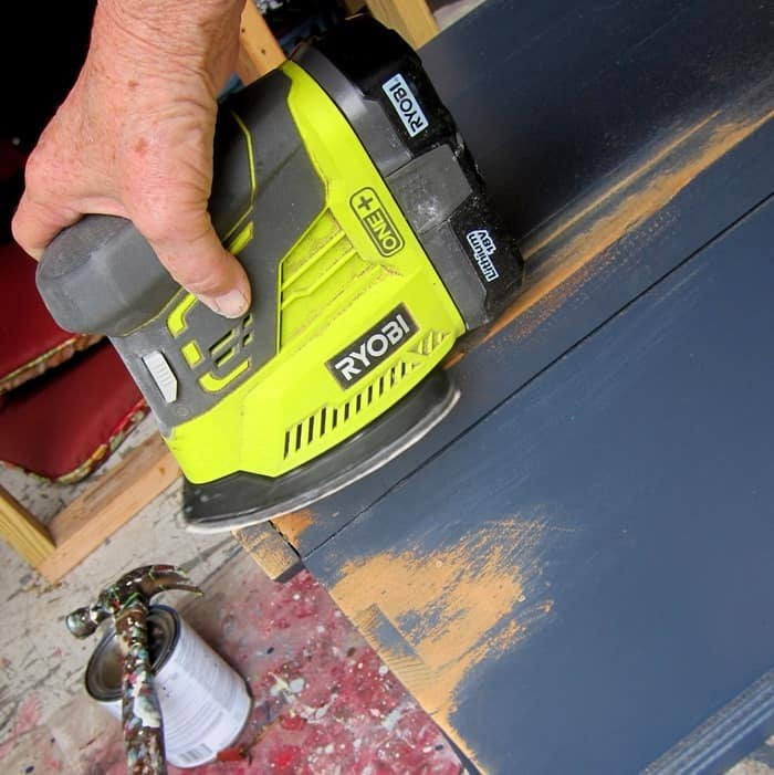 distressing painted furniture with a power sander