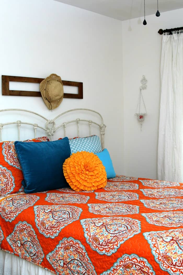 orange and turquoise bedroom makeover with white walls
