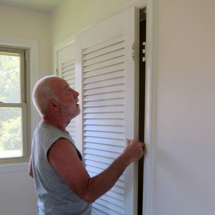 remove closet doors in preparation for painting with a paint sprayer