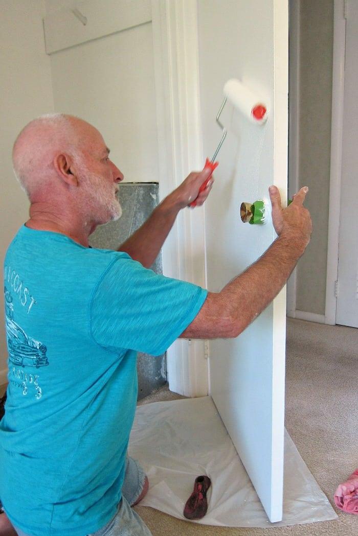 use painters tape around door knobs when painting doors